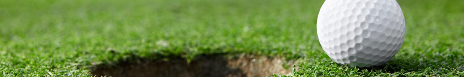 A golf hole and ball