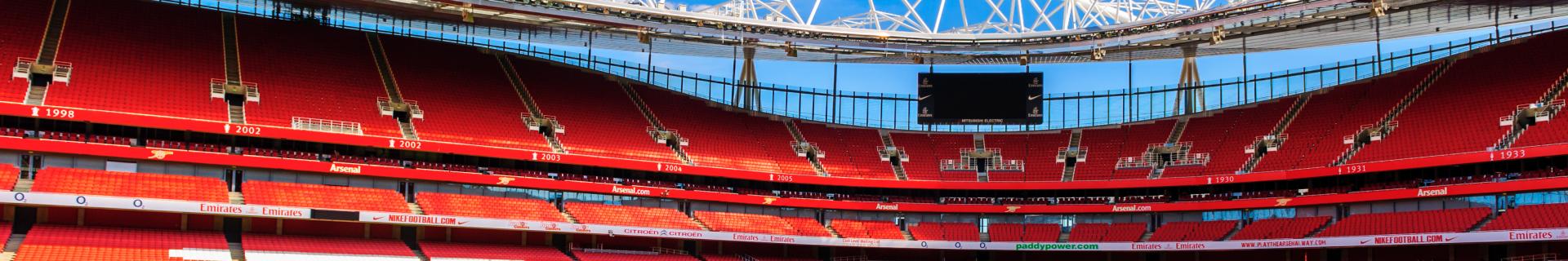 Panoramic photo of the red seats inside Arsenal's Emirates Stadium