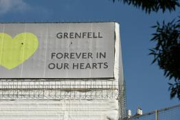 grenfell tower covered up with scaffolding