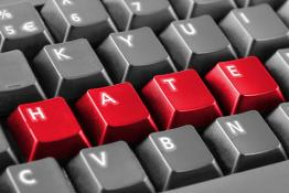 letters on a keyboard spelling HATE