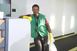 Cleaners' rights: male cleaner with rubber gloves and rubbish bag