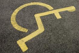 Painted wheelchair symbol in a disabled parking space