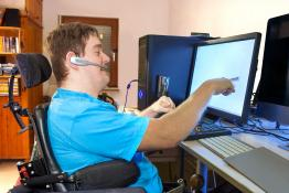Office worker using assistive technology
