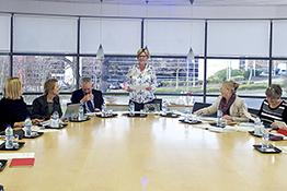 A group of people around a boardroom table