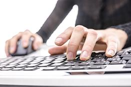 A person typing at a computer
