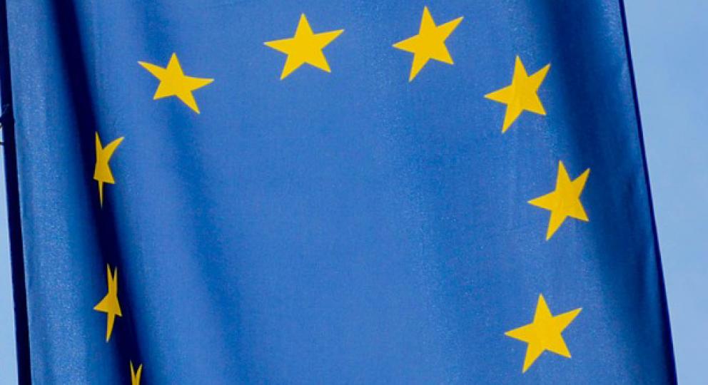 European Union flag hanging on a flag pole