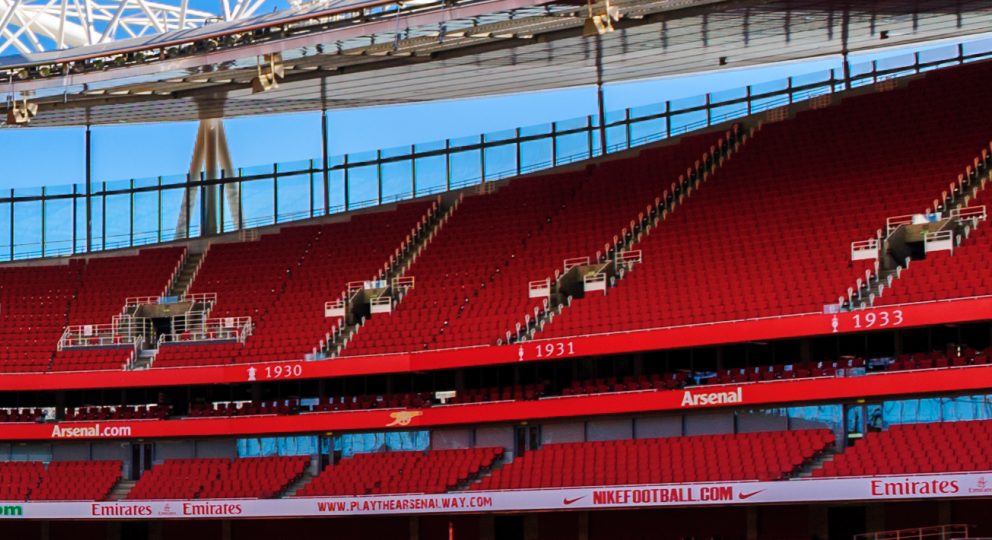 Panoramic photo of the red seats inside Arsenal's Emirates Stadium