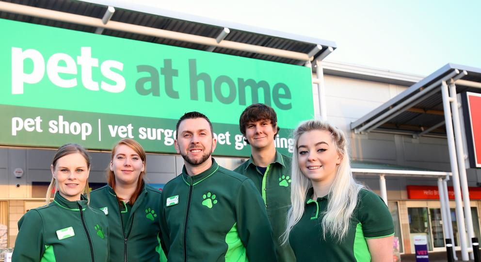 Pets at Home staff stood outside their store